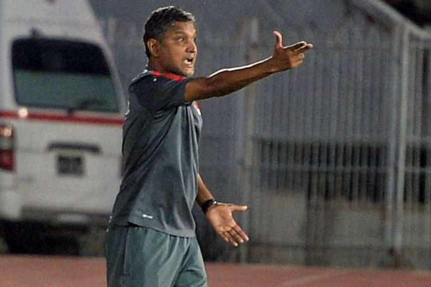 Singapore coach V. Sundramoorthy gesturing to his team during their AYA Bank Cup final match against Vietnam, on June 6, 2016.