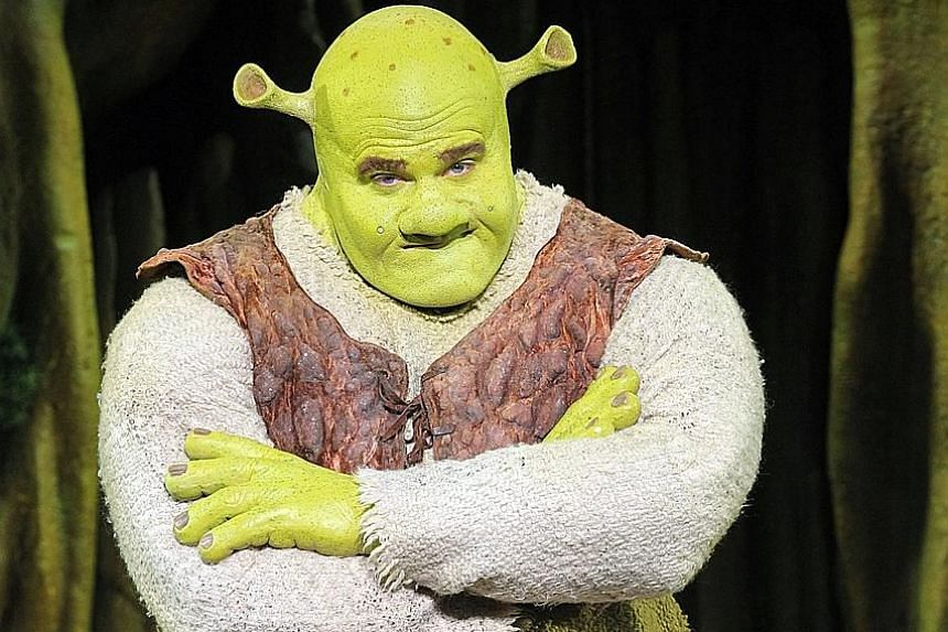 Actor Kyle Timson has to wear a big helmet and don a fat suit to play Shrek (above) in the musical.