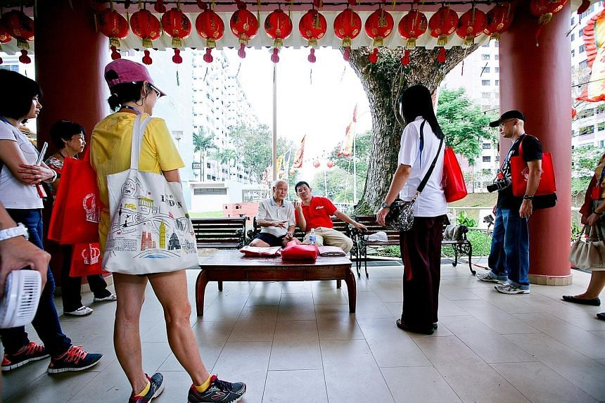 Participants learning more about Tiong Ghee Temple, the oldest Taoist temple in Queenstown. Now located in Stirling Road, it can trace its history back to the 1930s.