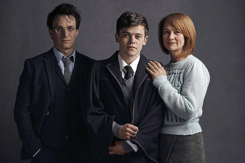 A grown-up Harry Potter played by Jamie Parker (far left), with Sam Clemmett and Poppy Miller as his son and wife in Harry Potter And The Cursed Child.