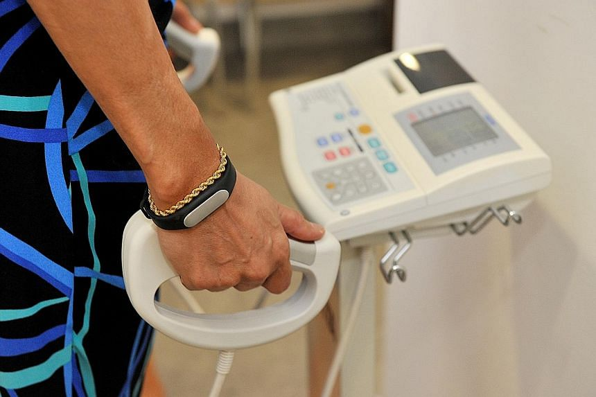 A volunteer on a body composition analyser, used to measure body weight and body fat distribution. Health Ministry figures show that more than one in four people here are diabetic, or are heading that way.