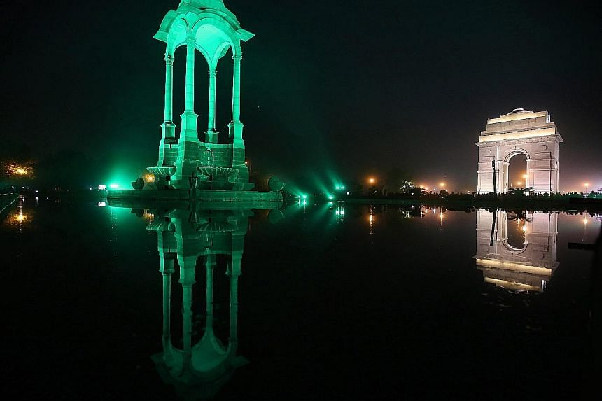 The Canopy (left) in New Delhi being lit up in green on Saturday, the eve of World Environment Day. The event is observed annually on June 5. It is the United Nations' most important day for encouraging worldwide awareness and action for environment