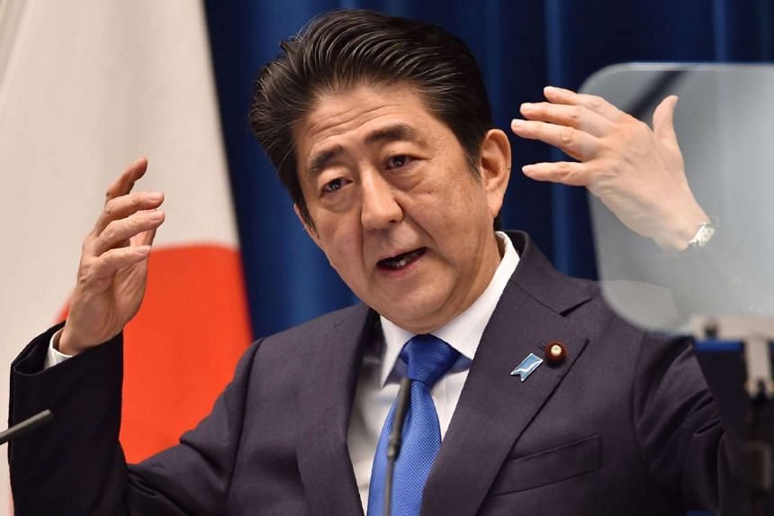 Japanese Prime Minister Shinzo Abe addresses a press conference at his official residence in Tokyo on June 1.