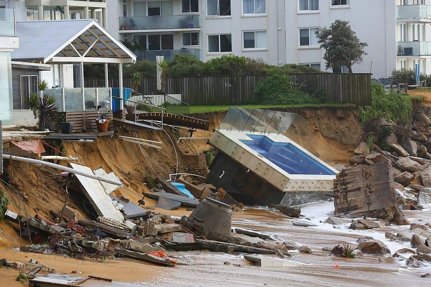 Waves crash against a garden swimming pool that was washed away from a property on the beach front after heavy rain and storms at Collaroy in Sydney's Northern Beaches, Australia, June 6.