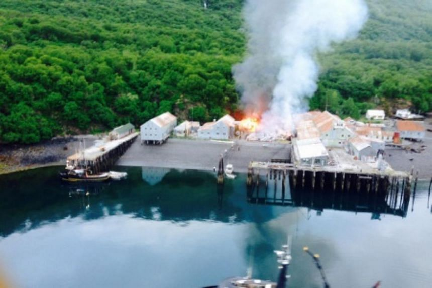 Responders assess the fire at the Park's Cannery near Uyak Bay on Alaska's Kodiak Island.