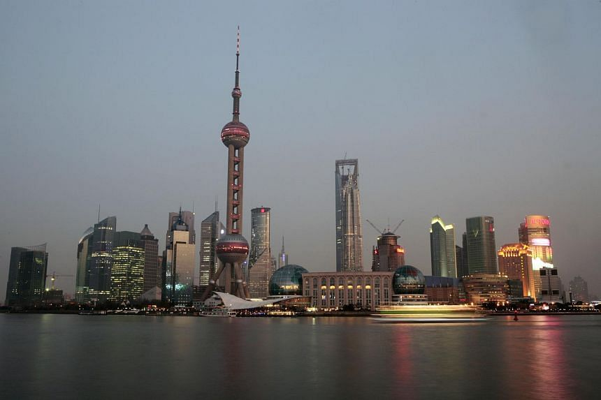 Buildings stand in the Pudong financial area in Shanghai, China, February 27, 2008.