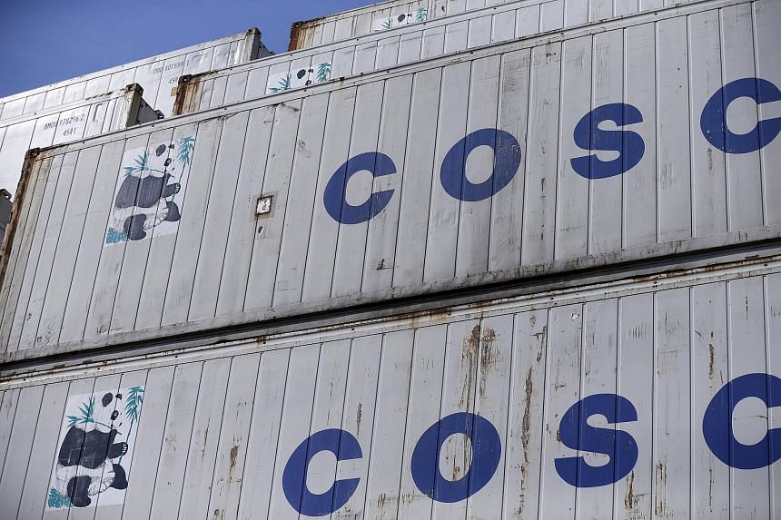 Containers from China Ocean Shipping Company (COSCO) pictured at a port in Shanghai, China, February 17.