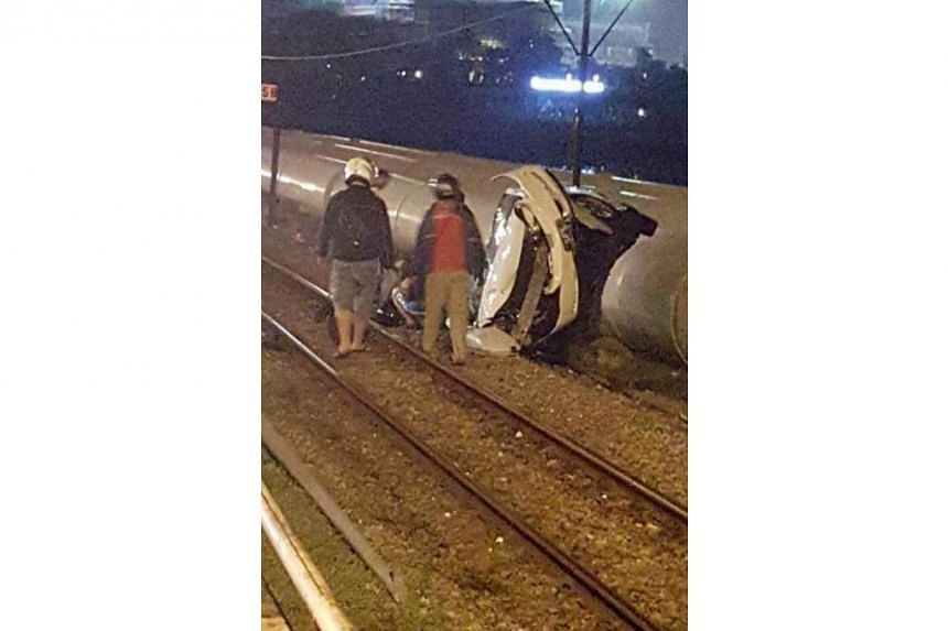 A Singapore-registered car crashed onto the railway tracks on the Causeway on Monday (June 6).