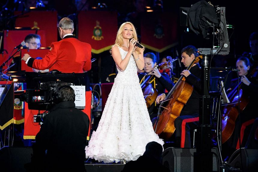 Australian singer Kylie Minogue performs for The Queen during the final night of The Queen's 90th Birthday Celebrations at the Royal Windsor Horseshow on May 15.