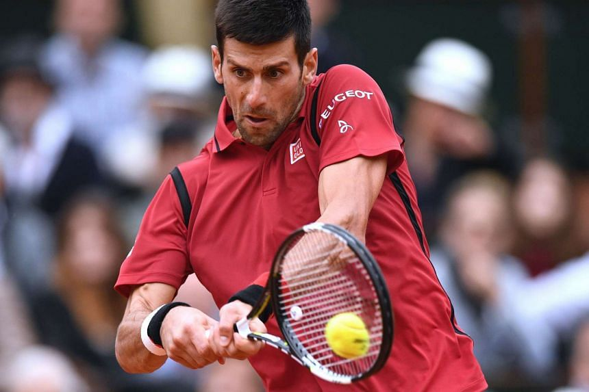 Djokovic returns a shot at the French Open.