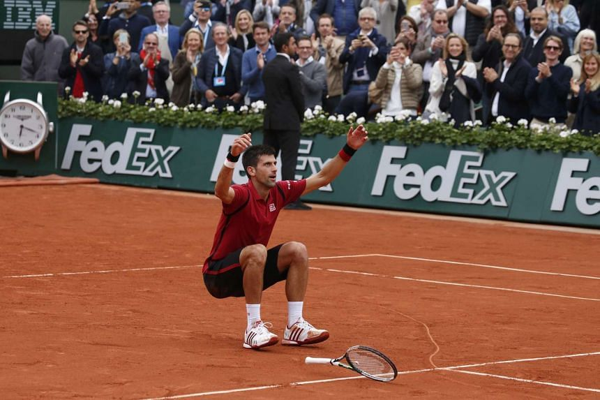 Djokovic jumps backwards into the somewhat indiscernible heart he drew in the clay court after winning the French Open.