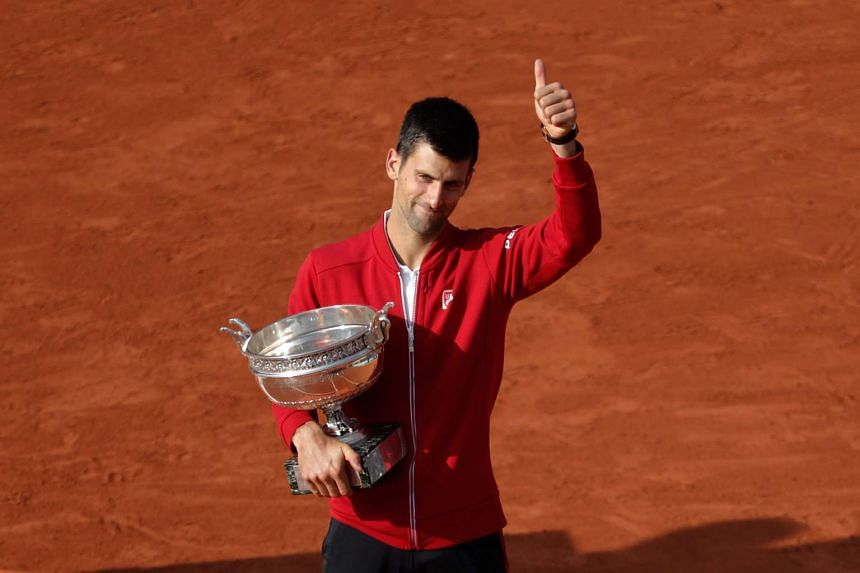 Winner Serbia's Novak Djokovic poses with the trophy after winning the men's title at the French Tennis Open in Paris on Sunday.