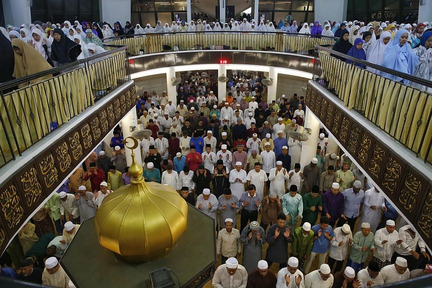 Muslim congregants performing evening prayers, also know as 'Tarawih', to mark the eve of the first day of Ramadan at Al-Mukminin Mosque in Jurong East Street 21 on June 17, 2015.