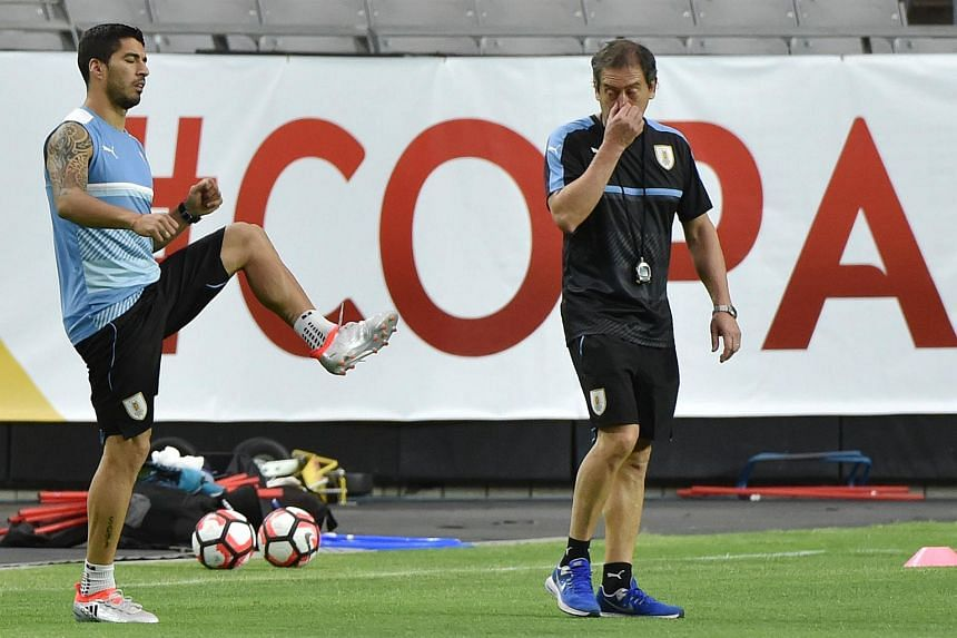 Uruguay player Luis Suarez (left) practices during a training session at University of Phoenix Stadium in Glendale, Arizona on June 4.