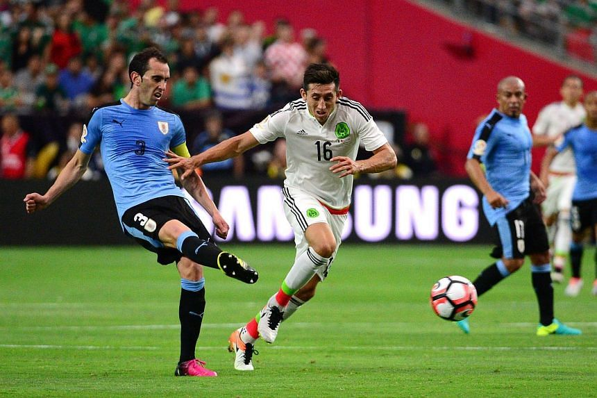 Diego Godin #3 of Uruguay passes the ball in front of Hector Herrera #16 of Mexico during the 2016 Copa America Centenario Group C match at University of Phoenix Stadium on June 5.