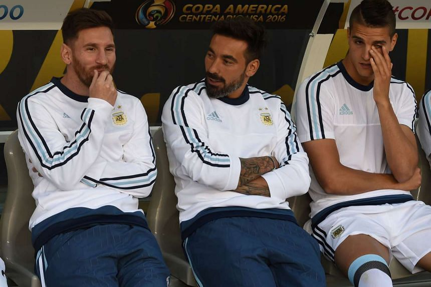 Lionel Messi (left) on the substitute's bench before the start of their Copa America Centenario football match against Chile in Santa Clara, California, on June 6, 2016.