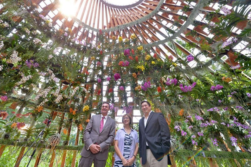 (From left) Shangri-La Hotel general manager Reto Klauser, former Orchid Society of South East Asia president Peggy Tan and Orba chairman Mark Shaw at the unveiling ceremony.