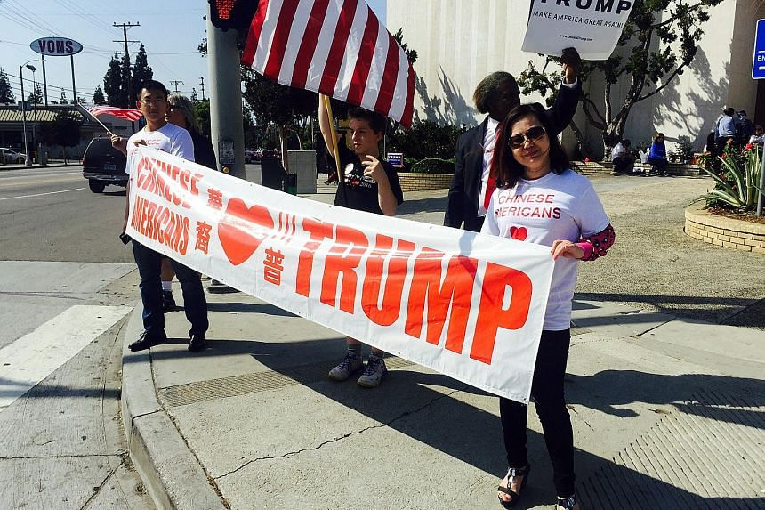 Asian-Americans who back Mr Trump - like these members of the Chinese-Americans For Trump group rallying support in Los Angeles - appear to be in the minority. A recent survey showed that 61 per cent of registered Asian-American voters have an unfavo