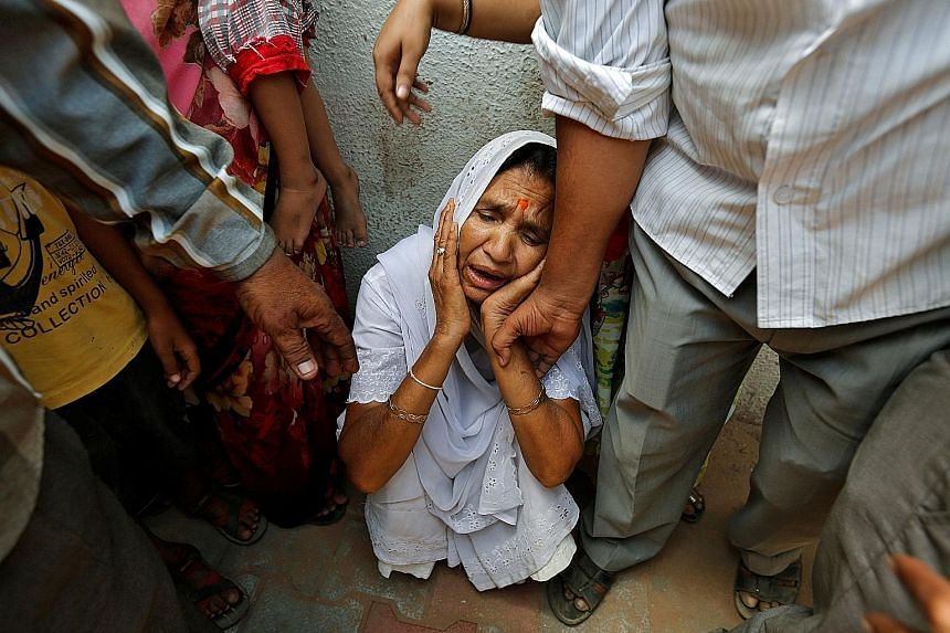 The mother of a man found guilty of involvement in the murders during the Gujarat riots outside the courtroom yesterday. The 24 men were convicted last week of playing a role in the massacre of 69 Muslims in 2002. The week-long violence in the state