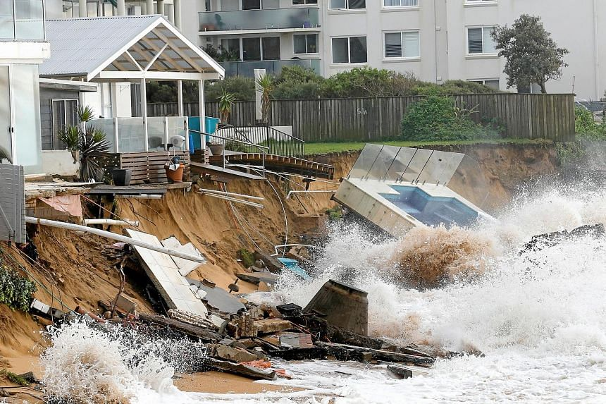 A garden swimming pool at a beachfront property being destroyed by crashing waves after heavy rain and storms hit the suburb of Collaroy in Sydney's Northern Beaches area yesterday. Major flooding and heavy rain are predicted to continue across parts