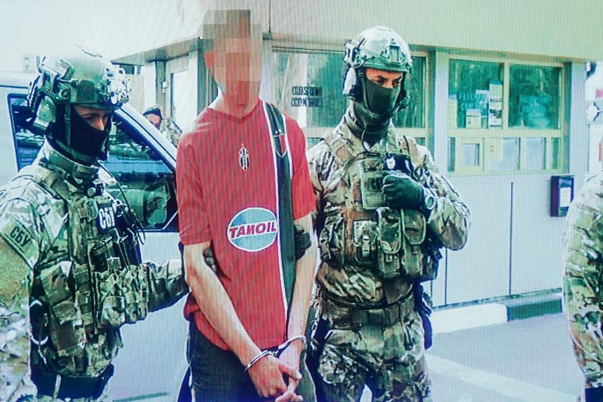 A still from an undated video showing an unidentified Frenchman being led away by members of Ukraine's SBU security service. It is unclear if the man is linked to any terror cell or is a lone wolf.
