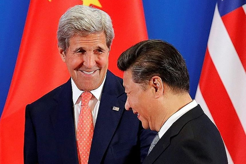 "Chinese President Xi Jinping with US Secretary of State John Kerry at the US-China Strategic and Economic Dialogue in Beijing yesterday. Noting that both countries share ""extensive mutual interests"", Mr Xi stressed the need to avoid a confrontational"