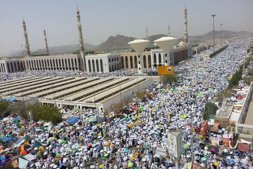 Muslim pilgrims gathered near Namirah Mosque in Arafah while performing the haj pilgrimage, where they remained until evening for prayer and Koran recitals.