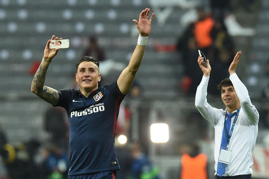 Atletico Madrid's Jose Maria Gimenez (left) and a teammate celebrate qualifying for the final after the UEFA Champions League semi-final on May 3.