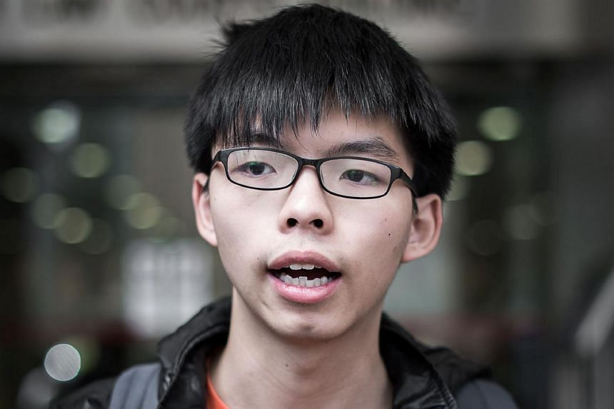 Student protester Joshua Wong speaking to the media outside the court of justice building in Hong Kong on Feb 29.