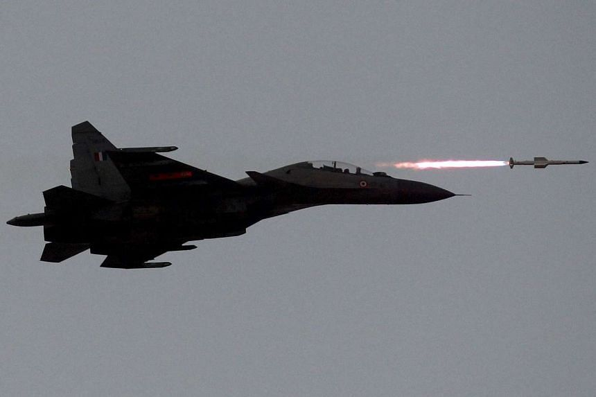 An Indian Air Force SU-30MKI aircraft fires an air-to-air missile during an exercise at Pokhran in the state of Rajasthan, India, on March 18, 2016.