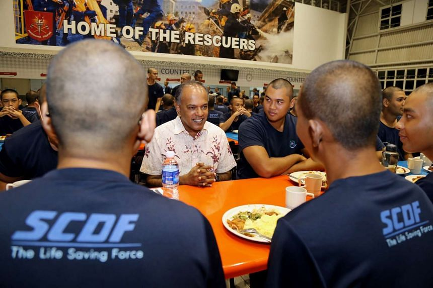 Home Affairs Minister K. Shanmugam with cadets from the Singapore Civil Defence Force at the National Service Training Institute on June 7, 2016.