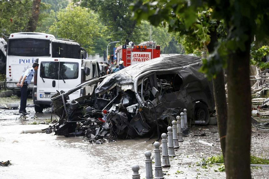 A destroyed van near a Turkish police bus which was targeted in a bomb attack in a central Istanbul district, Turkey, on June 7, 2016.