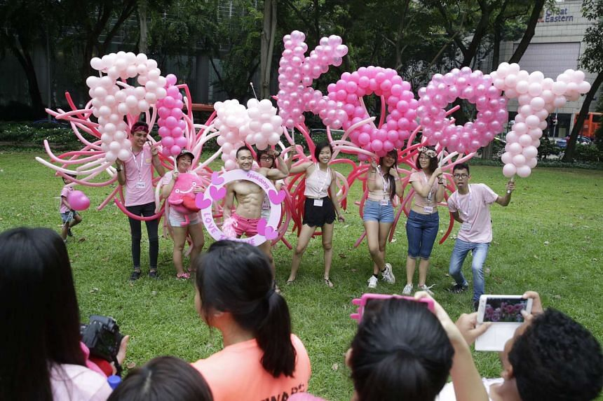 Participants posing with balloons at the Pink Dot event at Hong Lim Park on June 4, 2016.