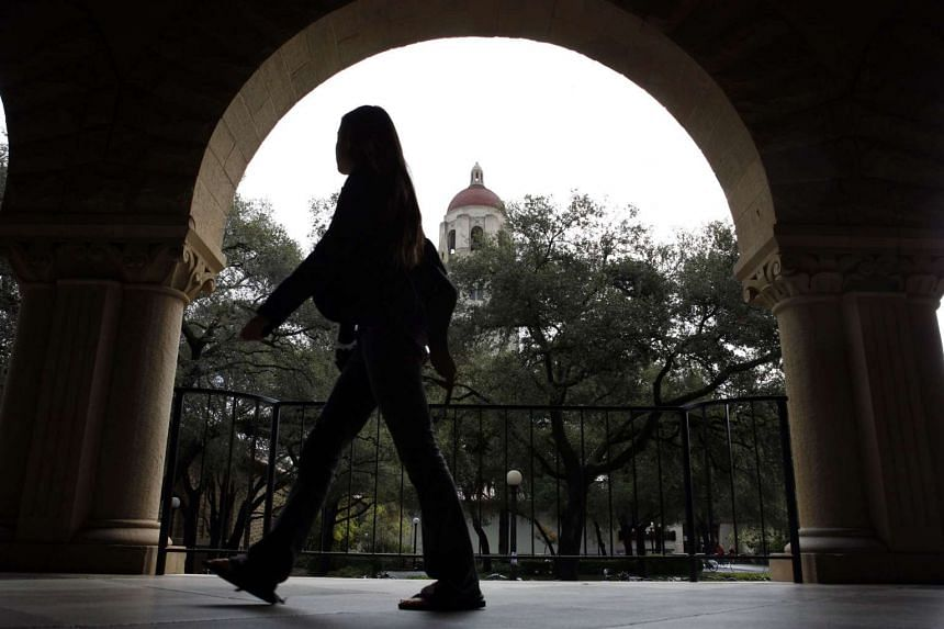 A student walks through the Stanford University campus in Palo Alto, California.