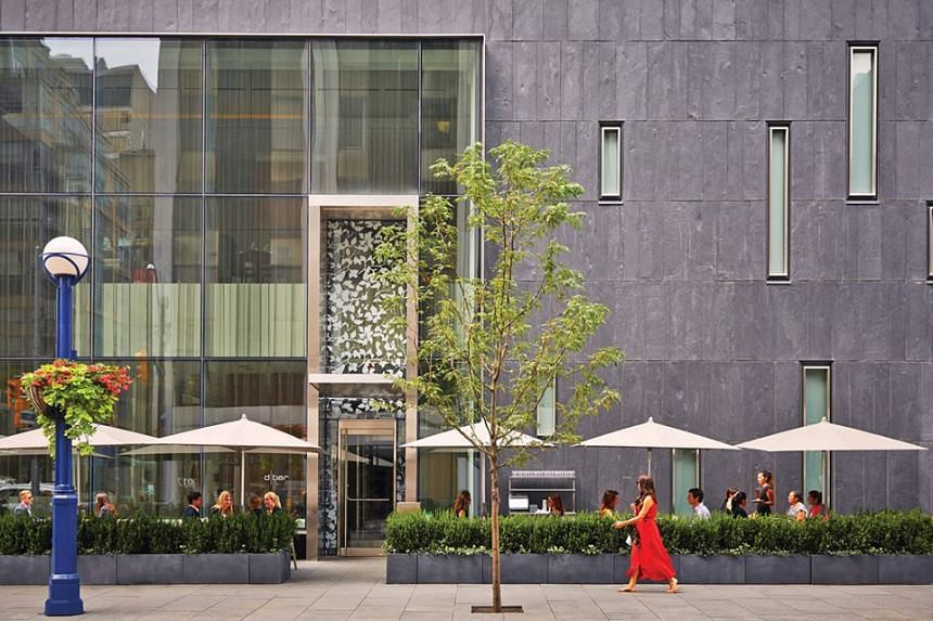 A promotional photo shows the Four Seasons Hotel in Toronto.