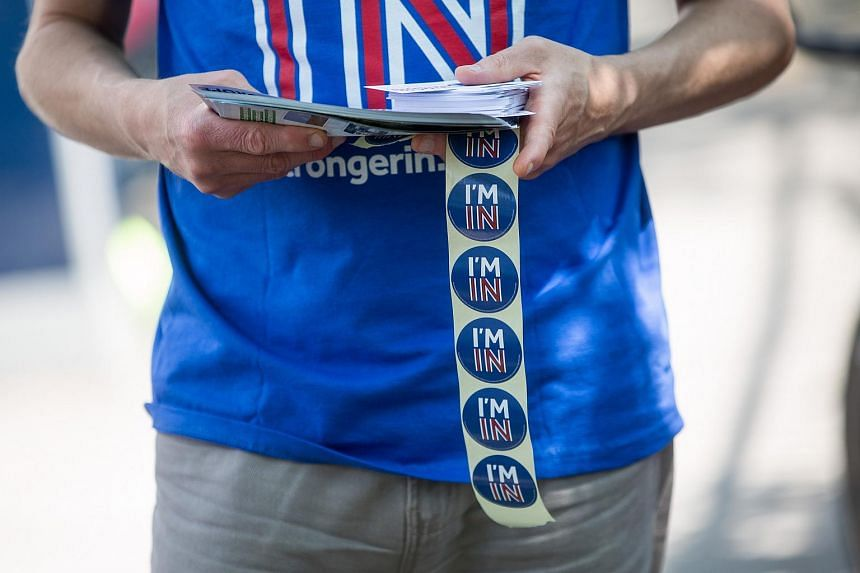 """A """"Britain Stronger in Europe"""" campaigner handing out leaflets and stickers to pedestrians in London on June 6."""