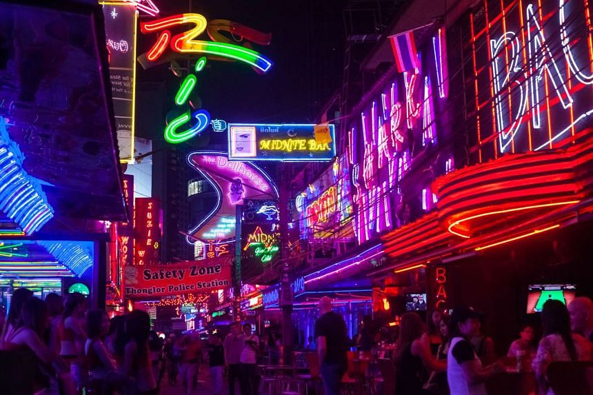 Neon bar signs and nightlife seen in Bangkok's red-light district.