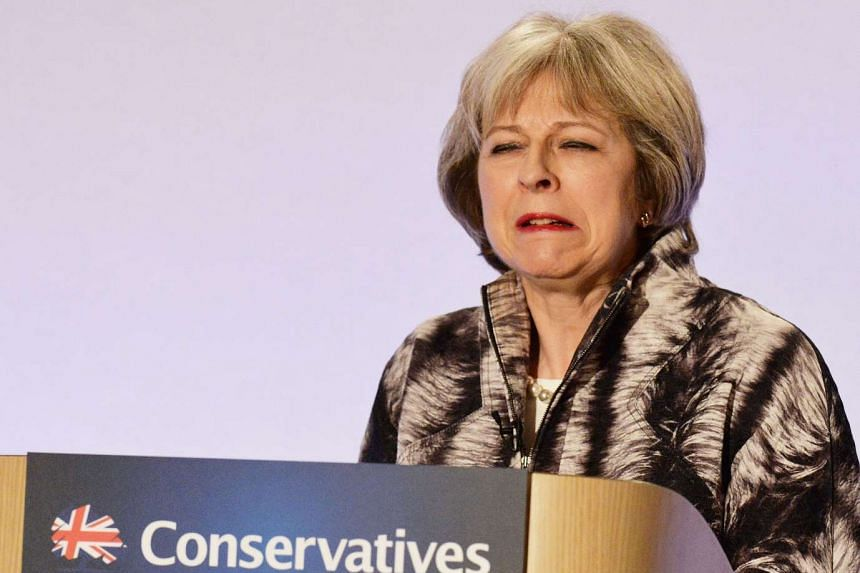 British Home Secretary Theresa May speaks at the Conservative party Spring Conference in central London on April 9, 2016.