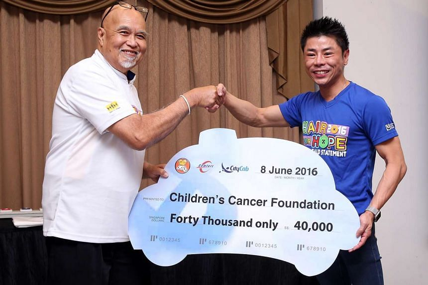 CabbyCare Charity Group Chairman Freddie Lee, with the total funds raised to be donated to Children's Cancer Foundation.