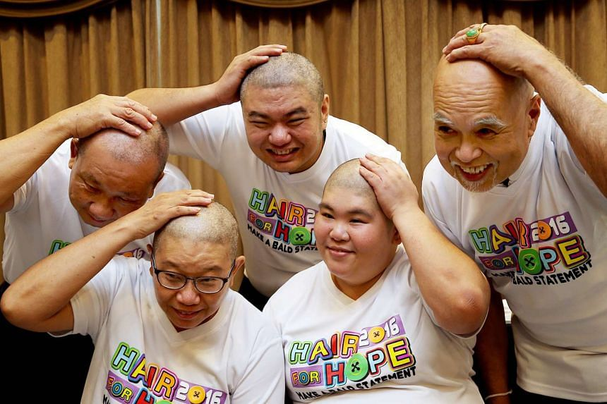 (Top, from left) CabbyCare vice-chairman Ang Kim Thye, cabby Stannley Chiok and CabbyCare Chairman Freddie Lee with (below) Kirsty Foo and Josephine Kee, the first two females to join Comfort DelGro's Hair for Hope event, after getting their hair sha