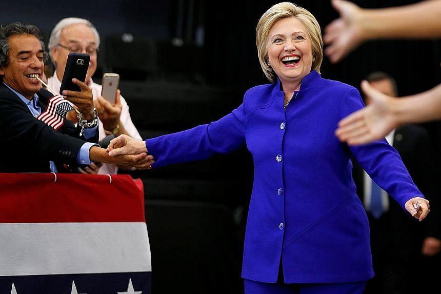 Mrs Clinton greeting supporters at a campaign stop in Long Beach, California, on Monday. Delegate counts by media outlets found that she had met the threshold needed to become the Democrats' presumptive nominee.