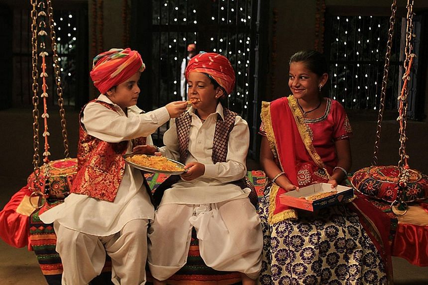 Krrish Chhabria (centre) and Hetal Gada (right) play orphan siblings who meet exotic characters on the road and learn not to judge books by their covers.