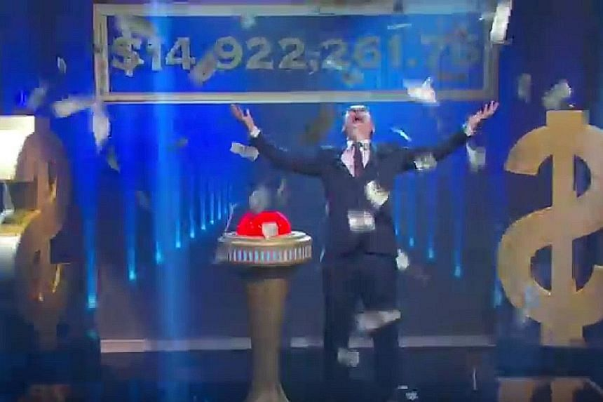 John Oliver giving away the debt in his show, Last Week Tonight.