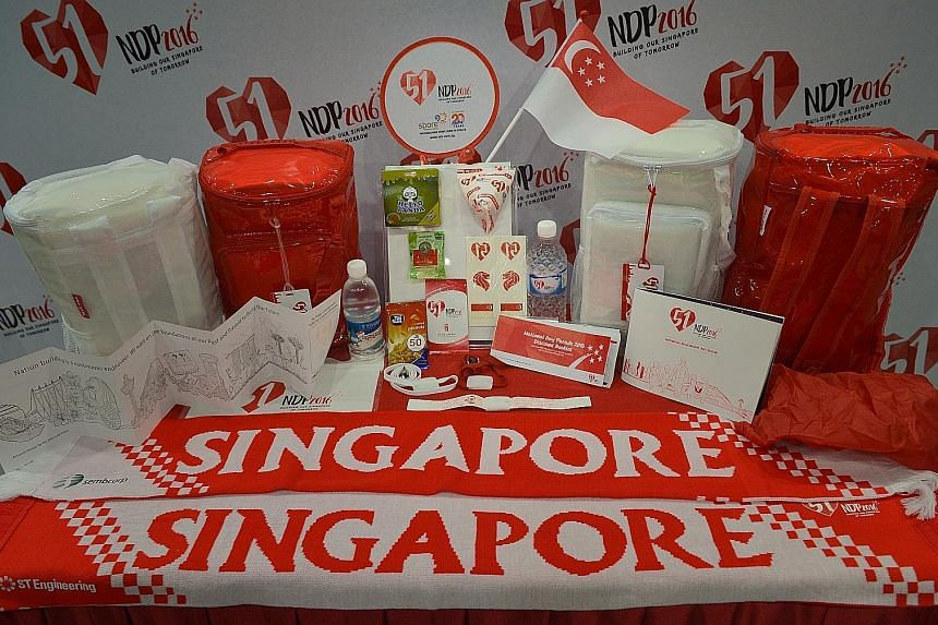 One of the highlights of the NDP 2016 funpack (above), which features 18 items, is an LED wristband (left) that is wirelessly programmed to blink in tandem with the show's lights and sounds. The goodie bag is made of translucent plastic for the first
