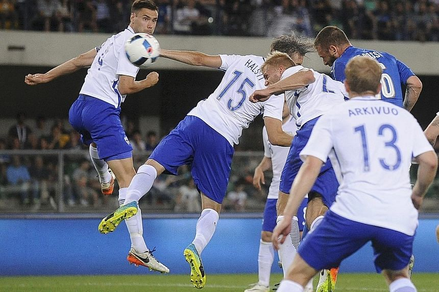 Daniele de Rossi (in blue) heading in Italy's second goal against Finland in a friendly match which ended 2-0. The Azzurri have also defeated Scotland in their preparation for the European Championship.