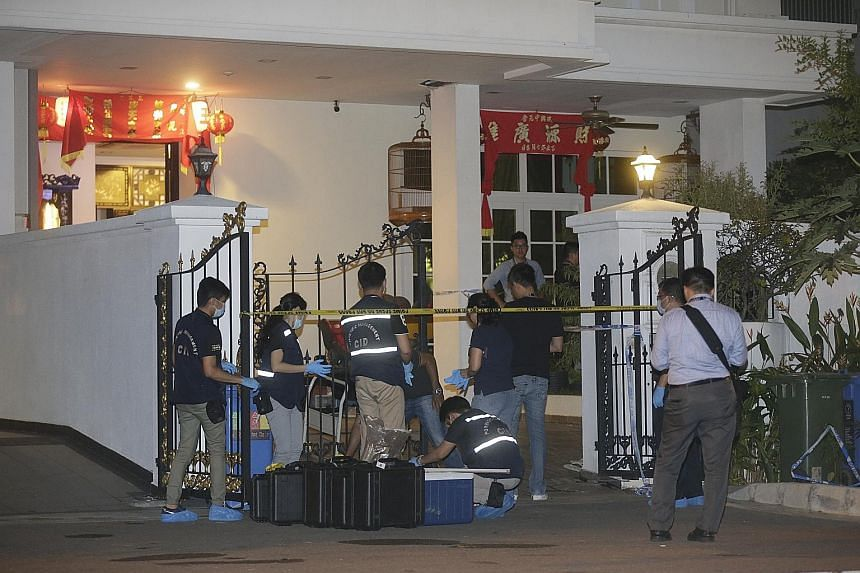Police carrying out investigations at 50C, Lorong H in Telok Kurau, where the alleged stabbings took place after 8pm yesterday. Police have classified the case as murder and are investigating.