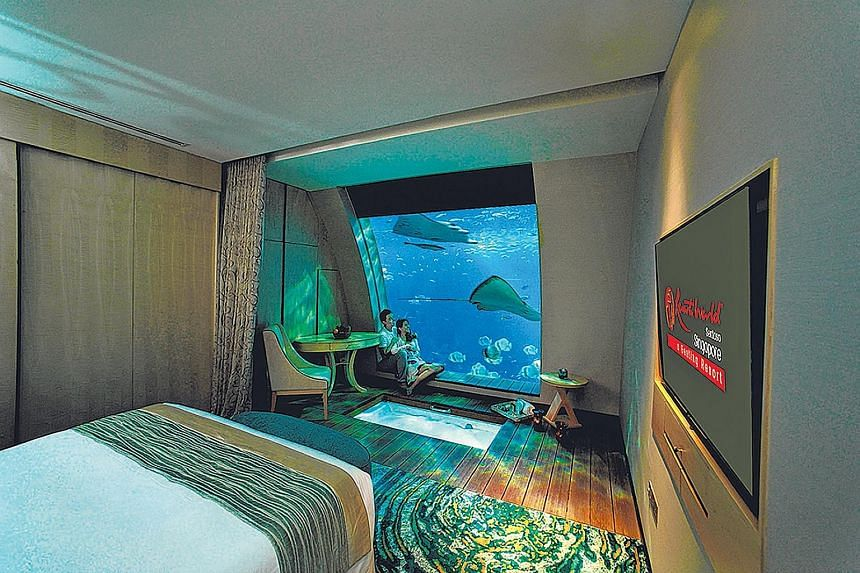 One lucky reader will win a trip for two to a destination of his choice. Also up for grabs are five two-day, one-night stays at Resorts World Sentosa, including a stay in an ocean suite with an underwater view (above).