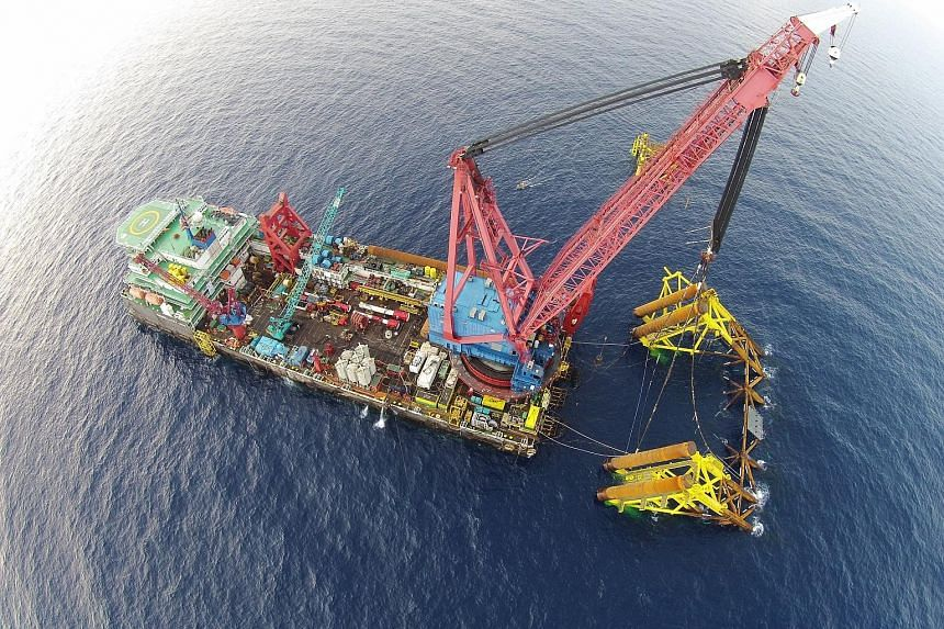 """An installation off Sarawak that Swiber completed in September last year. The offshore engineering services provider """"remains in a good position to weather the current industry downturn"""", said Mr Darren Yeo, its deputy group chief executive officer."""