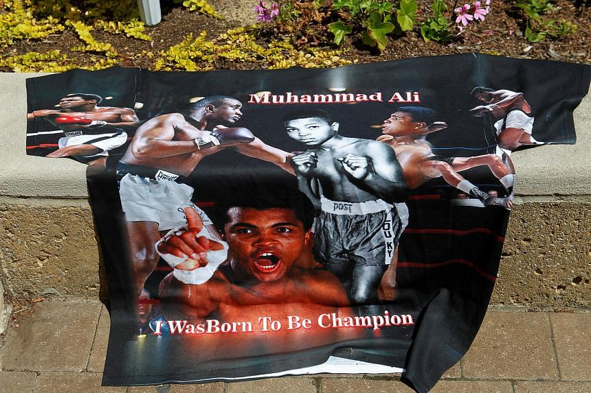 Fans of Muhammad Ali leaving pictures and personal mementos as they pay their respects at the Ali Centre in Louisville, Kentucky, on June 7.