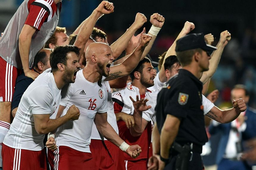 Georgia's players celebrating their 1-0 victory over Spain.